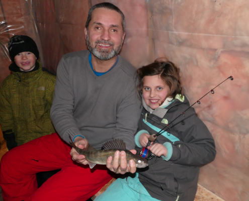 Lilly's catch of the day sitting in shelter with Lawrence and Theo