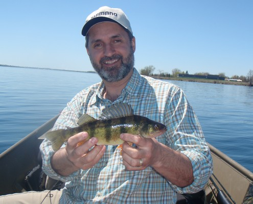 """Lawrence holding a 12"""" Perch he caught the weekend before on the St. Lawrence"""