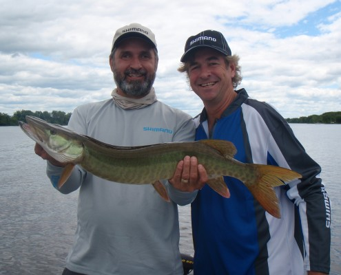 Lawrence and John Anderson holding a 34 inch Musky