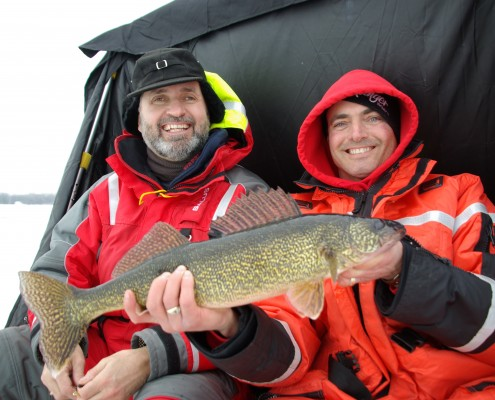 Scott Campbell and Lawrence holding up a fish