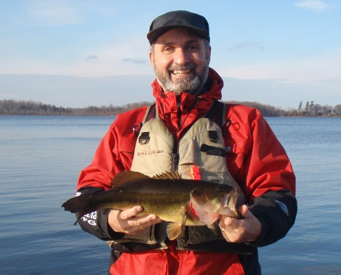 Lawrence holding a large mouth bass