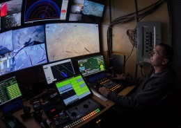 Inside the ROPOS Command Centre, pilot X operates the submerged ROPOS during a dive streaming live video. The ROPOS is a state-of-the-art underwater robot that can collect samples and scientific data as well as high definition video while submerged during the Gulf of St. Lawrence Expedition. The expedition is a joint venture between Oceana Canada and Fisheries and Oceans Canada. Nova Scotia.