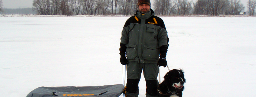 Lawrence Gunther and Guide Dog Moby on Ice