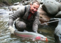 Greg Taylor holding a wild Pacific Salmon