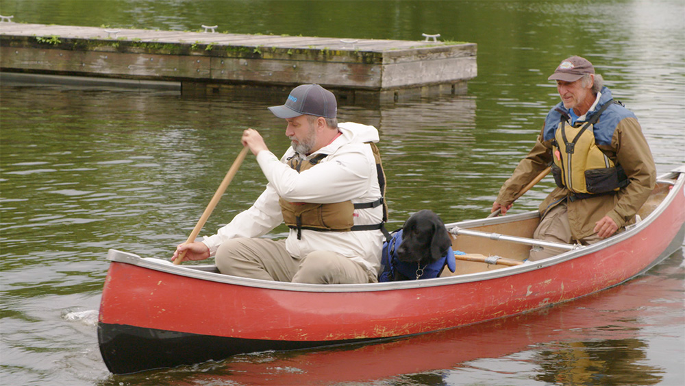Lawrence, Lewis and Max canoeing
