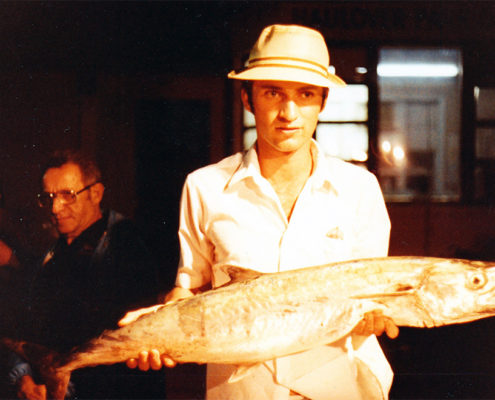 Photo of Lawrence holding a big fish
